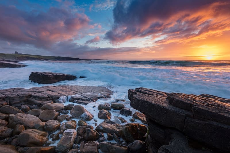 Coastal sunset over Classie Bawn Castle, Mullaghmore, County Sligo, Ireland.