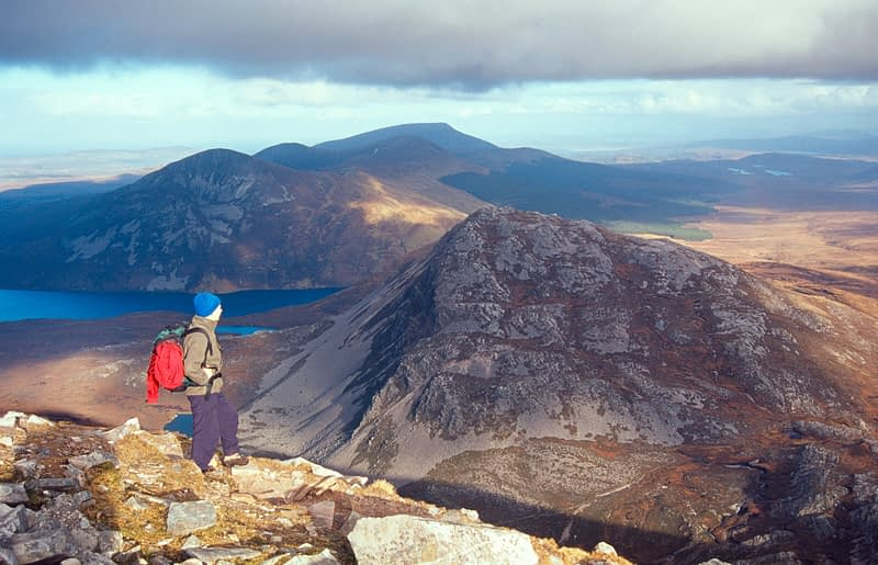 Walker looking to the Aghlas from Errigal Mountain, Co Donegal, Ireland.