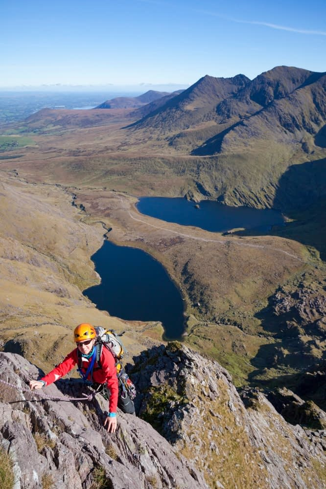 Rock climber on Howling Ridge, above Hag's Glen, Carrauntoohil, MacGillycuddy's Reeks, County Kerry, Ireland.