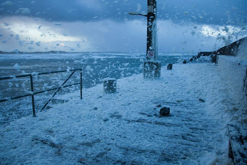 A storm of sea foam, Enniscrone pier, County Sligo, Ireland.