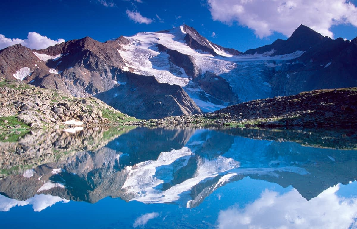 Reflection of the Wilder Freiger, Stubai Hohenweg, Tirol, Austria.