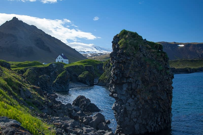 Coast and mountain scenery at Arnarstapi, Snaefellsnes Peninsula, Vesturland, Iceland.