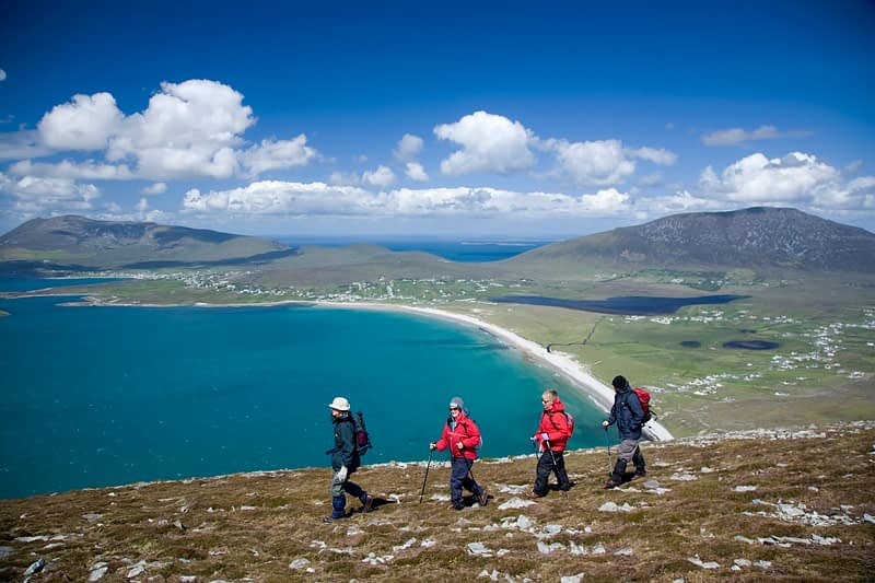 Walkers on the Menawn Cliffs above Trawmore, Achill Island, Co Mayo, Ireland.