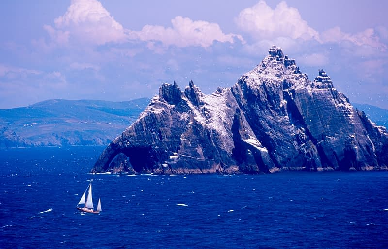 Sailing boat passing Small Skellig, Skellig Islands, Co Kerry, Ireland.