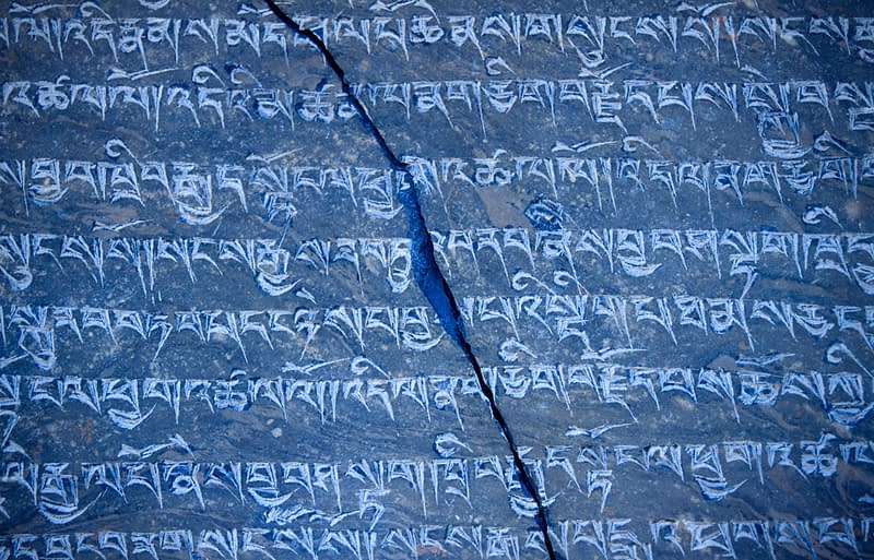 Mani stone carved with buddhist prayers, Annapurna region, Nepal.