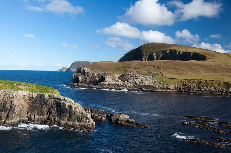View across Porturlin bay to the North Mayo seacliffs, Co Mayo, Ireland.