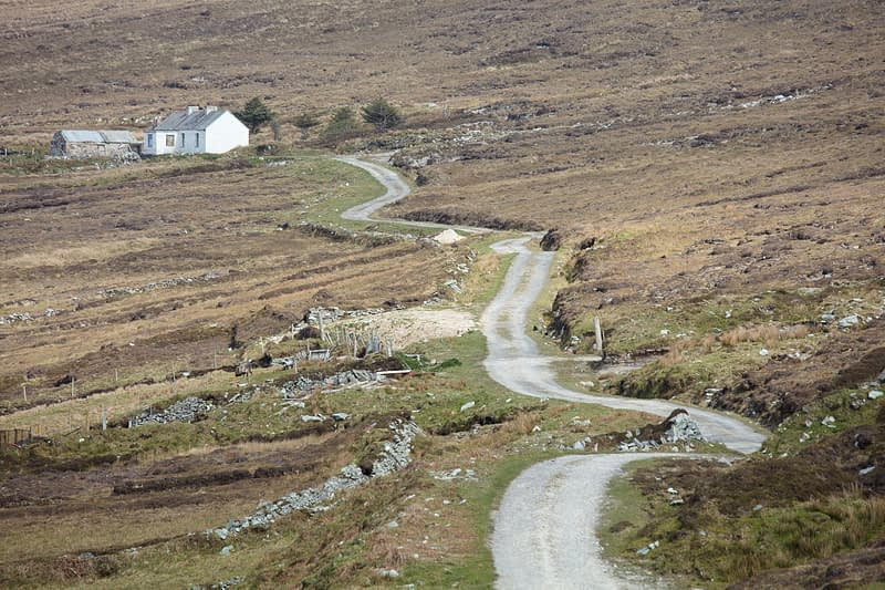 Remote cottage on boggy hillside, Achill Island, County Mayo, Ireland.