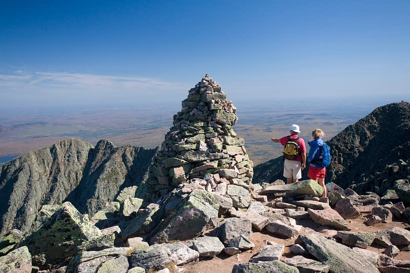 Hikers at the summit of  Mt Katadhin, Baxter State Park, Maine, USA.