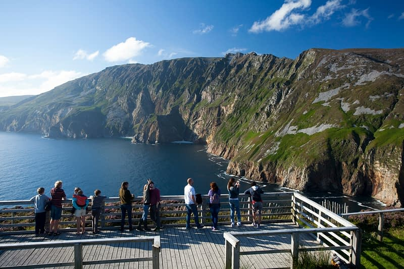 Visitors looking out from Slieve League viewing area, Bunglas, County Donegal, Ireland.