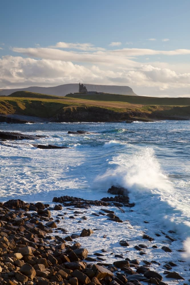 Waves breaking beneath Classie Bawn Castle, Mullaghmore Head, Co Sligo, Ireland.