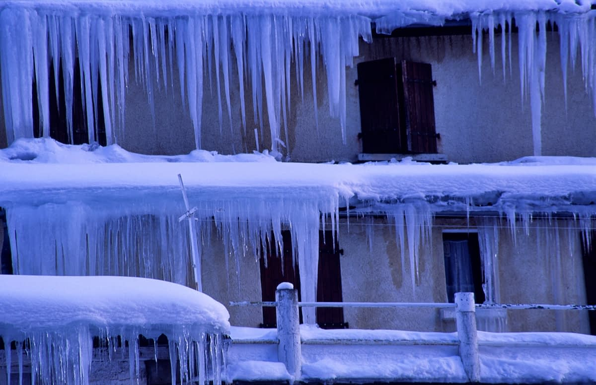 Winter icicles decorate a chalet, Bareges, French Pyrenees, France.