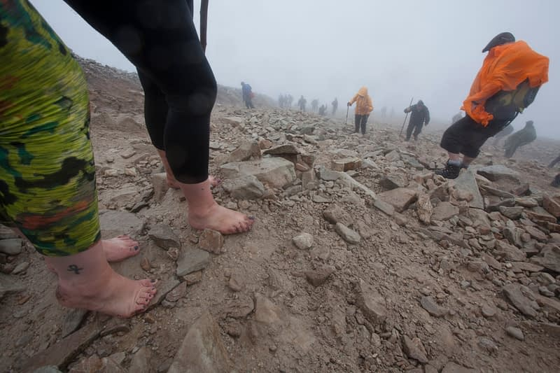 Barefoot pilgrims on Croagh Patrick, Reek Sunday, County Mayo, Ireland.