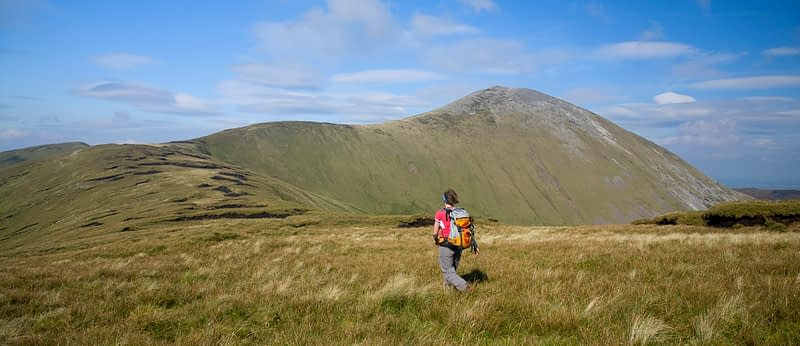 Walker on Birreencorragh's southwest ridge, Nephin Beg Mountains, Co Mayo, Ireland.