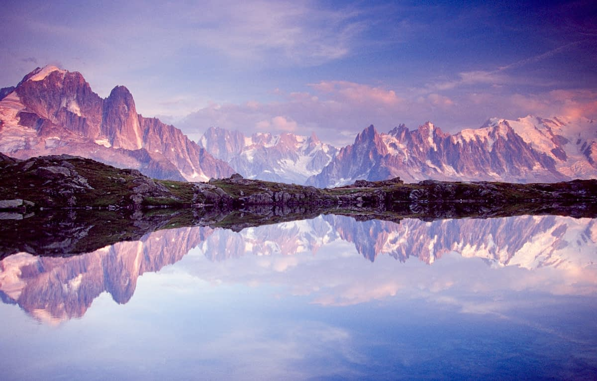 Dawn reflections of the Chamonix Aiguilles in Lac des Cheserys, French Alps, France.