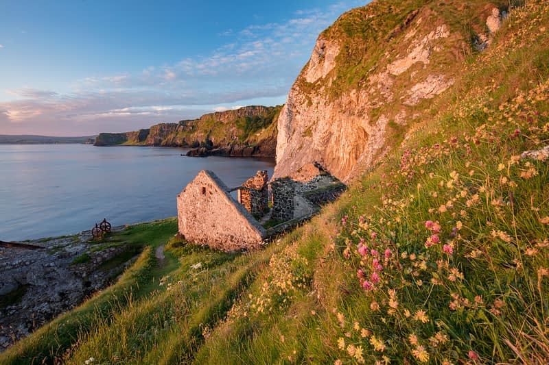 Old fishing cottage beneath the cliffs at Kinbane Head, Ballycastle, Country Antrim, Northern Ireland.
