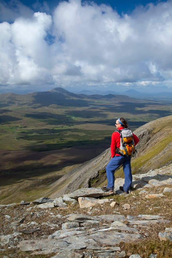Walker looking towards Croagh Patrick from Sheeffry East, Sheeffry Hills, Co Mayo, Ireland.