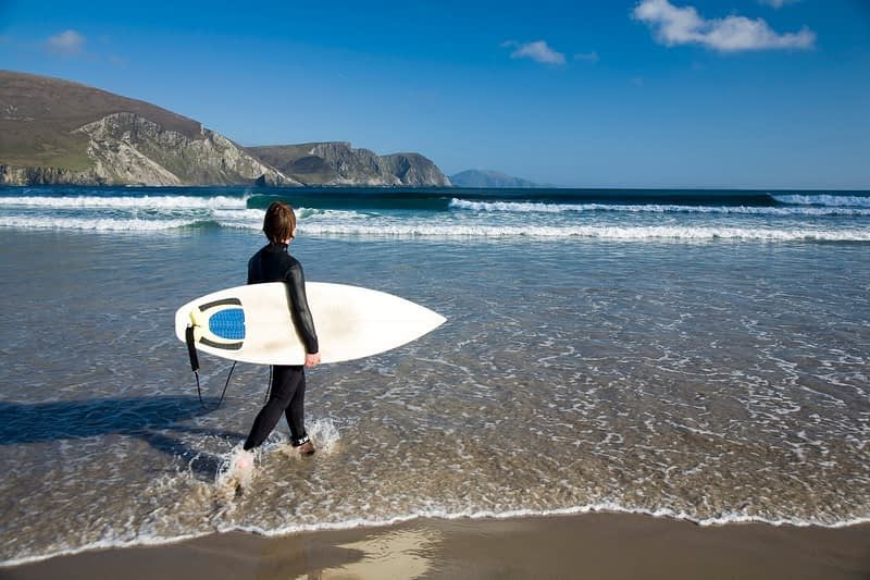 Surfer on Trawmore, Achill Island, Co Mayo, Ireland.