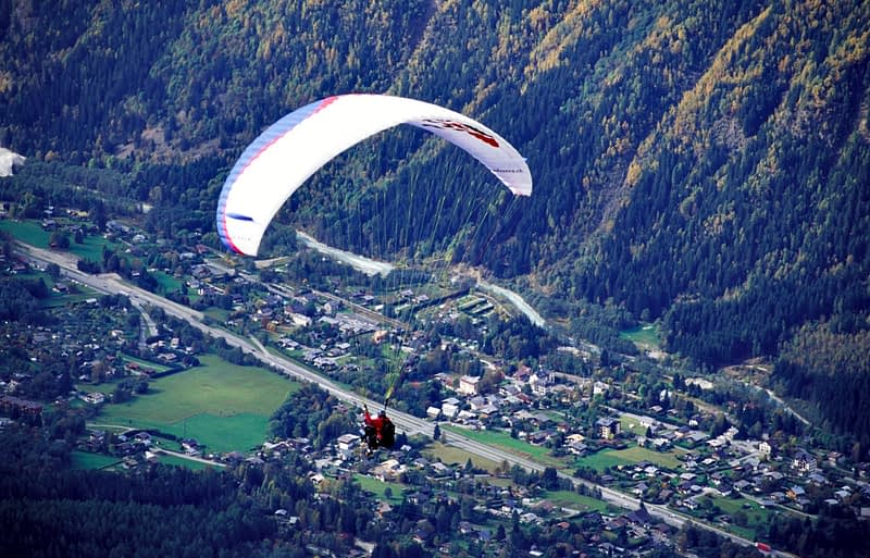 Parascending above the Chamonix Valley, French Alps, France.