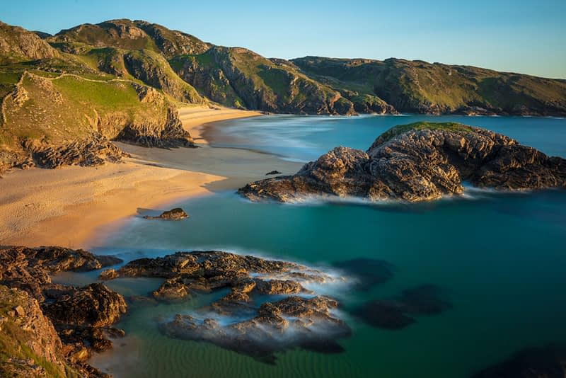 View over Boyeeghter Strand or The Murder Hole, Melmore Head, County Donegal, Ireland.