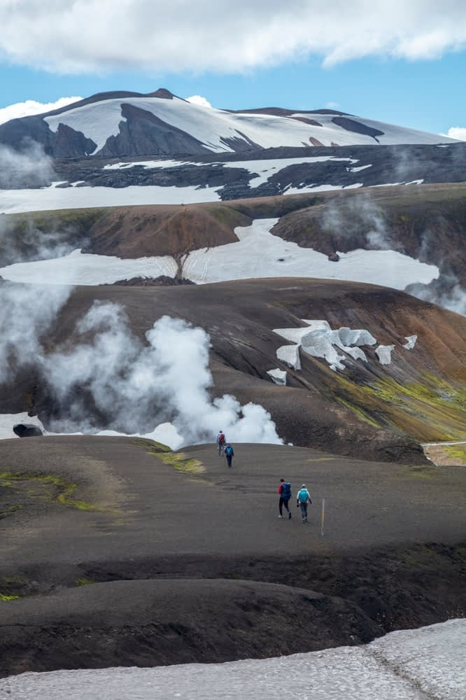 Hikers on the Laugavegur trail  near Storihver hot springs, Hrafntinnusker. Central Highlands, Sudhurland, Iceland.