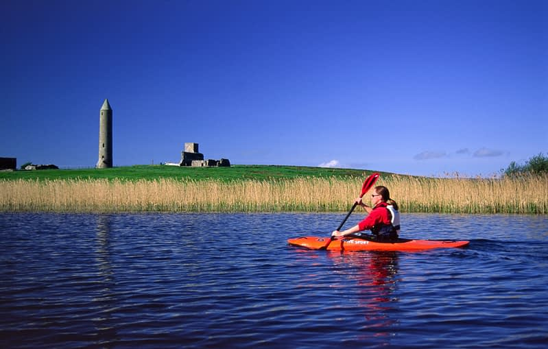 Kayaking past Devenish Island, Lower Lough Erne, Co Fermanagh, Northern Ireland.