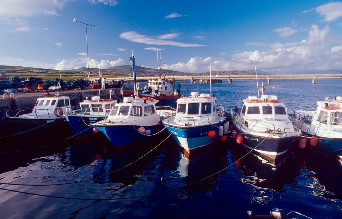 Boats lined up at Portmagee pier, Co Kerry, Ireland.