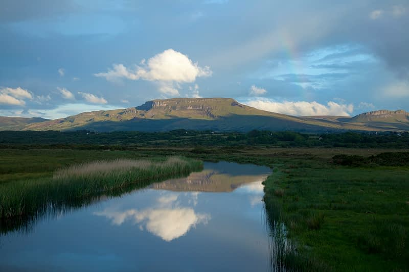 Mountain reflected in Drowes River, Co Leitrim, Ireland.