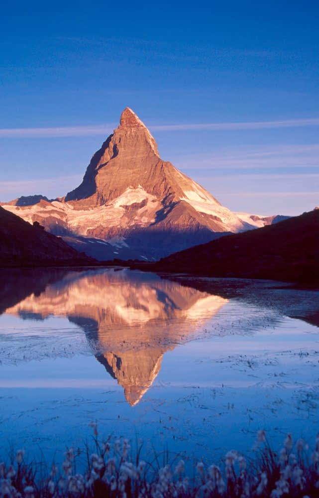 The Matterhorn reflected in the Riffelsee, Valais, Swiss Alps, Switzerland.