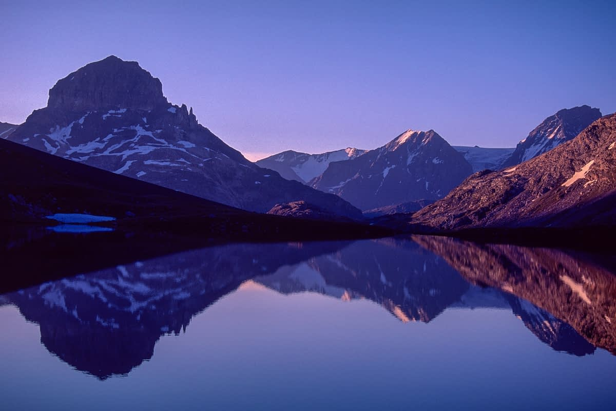 Dawn reflections in Lac Rond, Parc National de la Vanoise, French Alps, France.