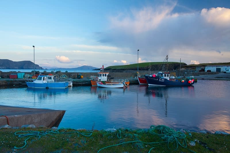 Evening fishing boats at Purteen Harbour, Achill Island, Co Mayo, Ireland.