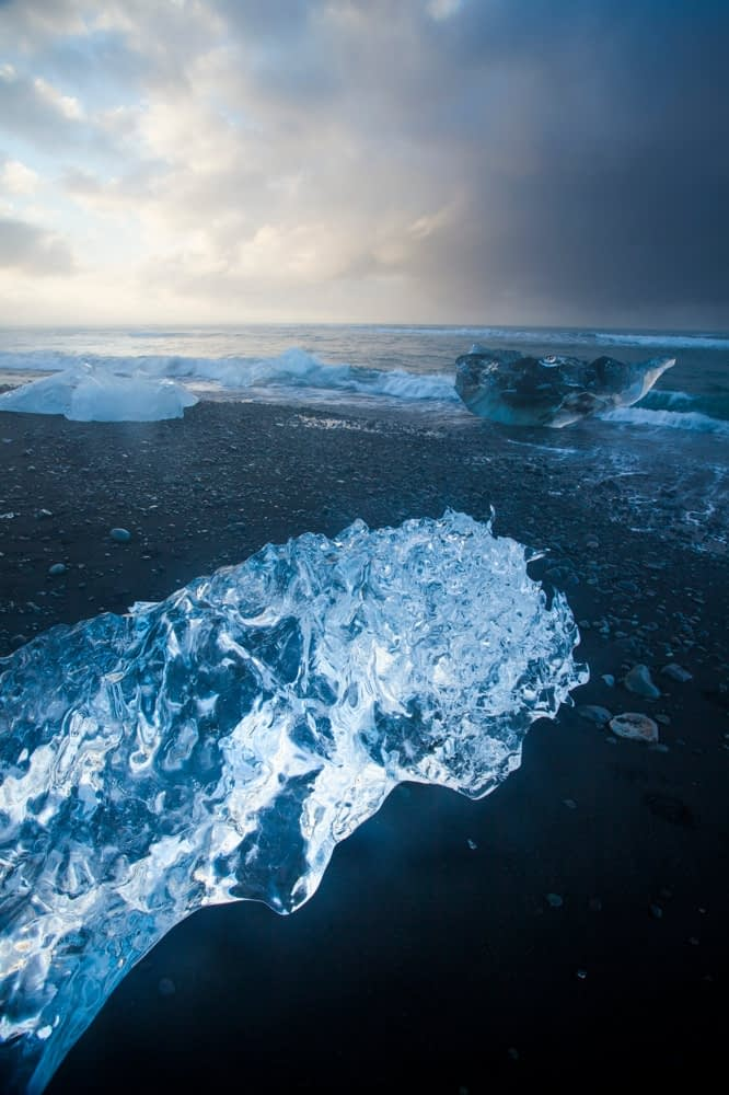 Icebergs on the black sand beach beneath Jokulsarlon, Sudhurland, Iceland.