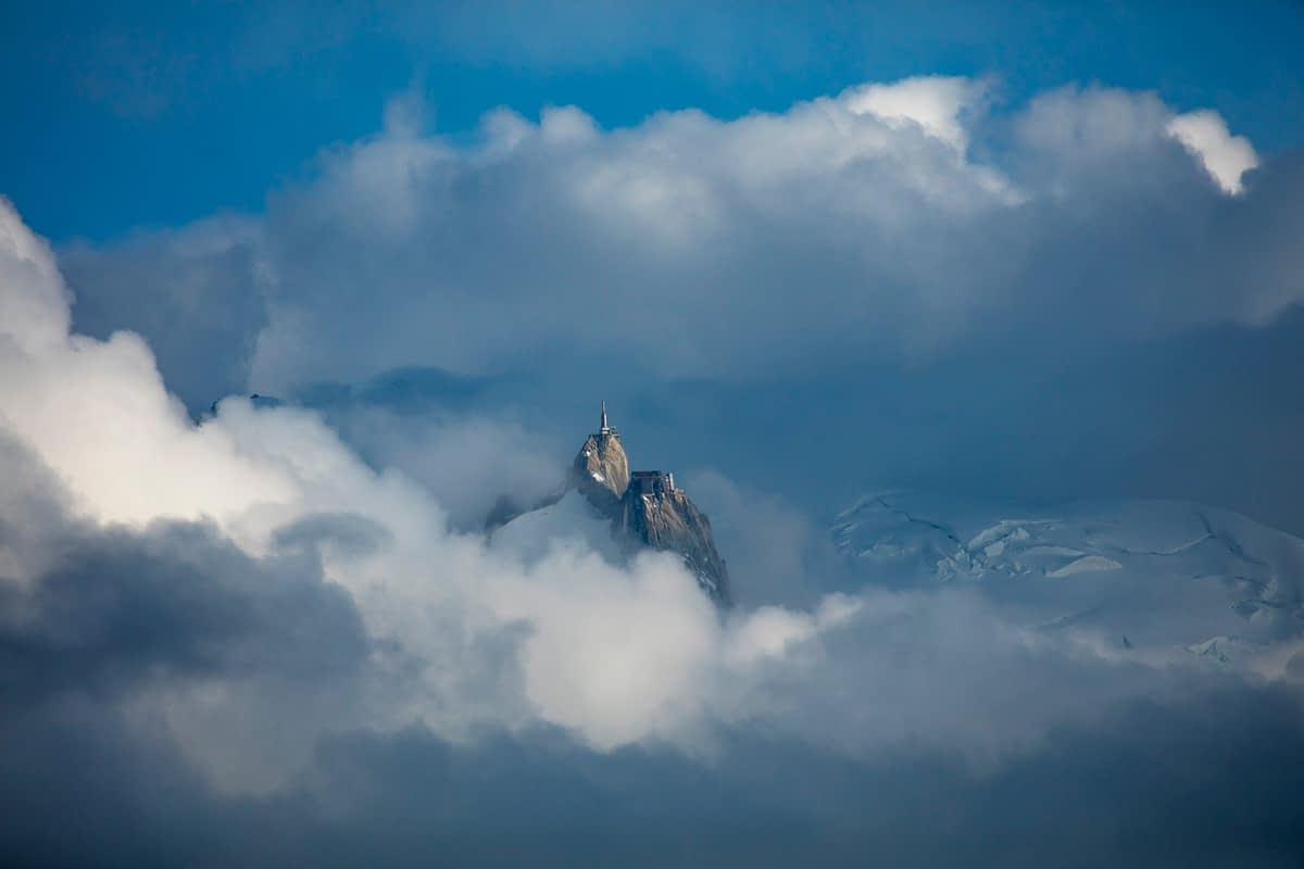 The Aiguille du Midi pokes above the cloud, Chamonix Valley, French Alps, France.