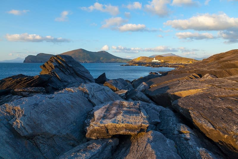 Rocky coastline near Cromwell Point lighthouse, Valentia Island, County Kerry, Ireland.