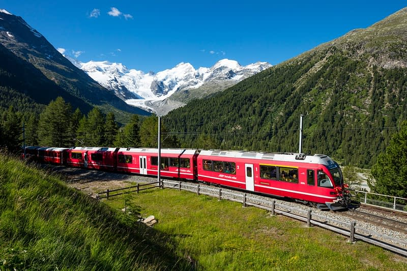 Berniner Express train beneath Morteratsch Glacier, Berniner Alps, Switzerland.