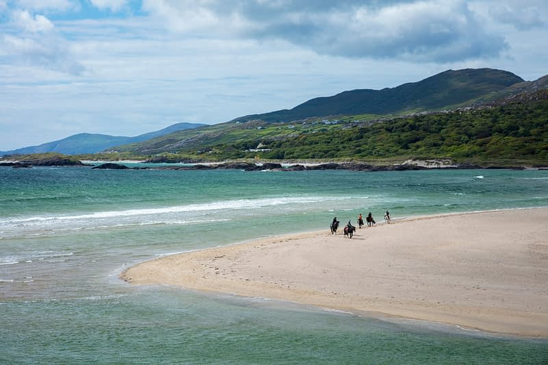 Horse riders on Derrynane Beach, Caherdaniel, County Kerry, Ireland.