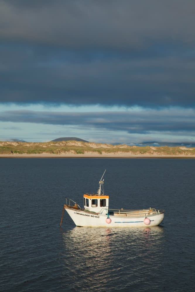 Fishing boat moored in Broadhaven Bay, Carrowteige, Co Mayo, Ireland.