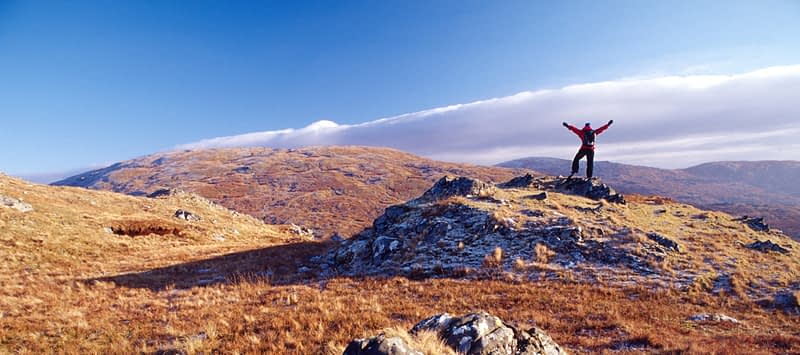 Winter walker near the summit of Lavagh Beg, Bluestack Mountains, Co Donegal, Ireland.