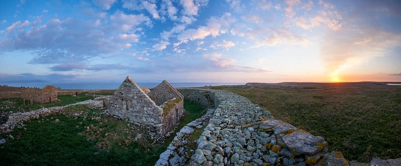 Sunset over the monastic settlement and cashel, Inishmurray Island, County Sligo, Ireland.