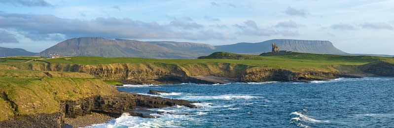 Classie Bawn Castle and the Sligo Hills, Mullaghmore, Co Sligo, Ireland.