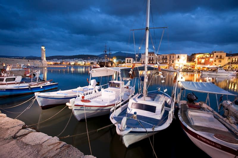 Dusk over the Venetian harbour, Rethymnon, Crete, Greece.