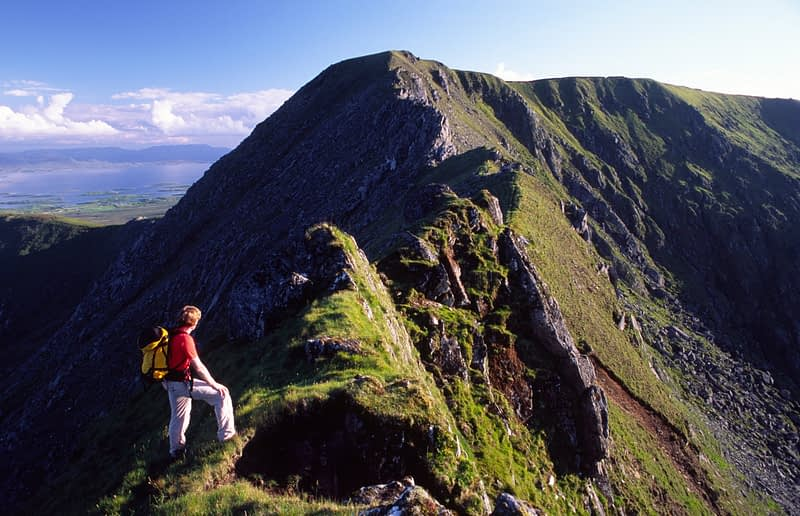 Walker on the Corranbinna Ridge, Nephin Beg Mountains, Co Mayo, Ireland.