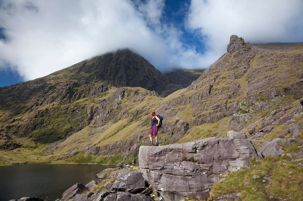 Hiker and Lough Gouragh beneath Carrauntoohil, MacGillycuddy's Reeks, County Kerry, Ireland.