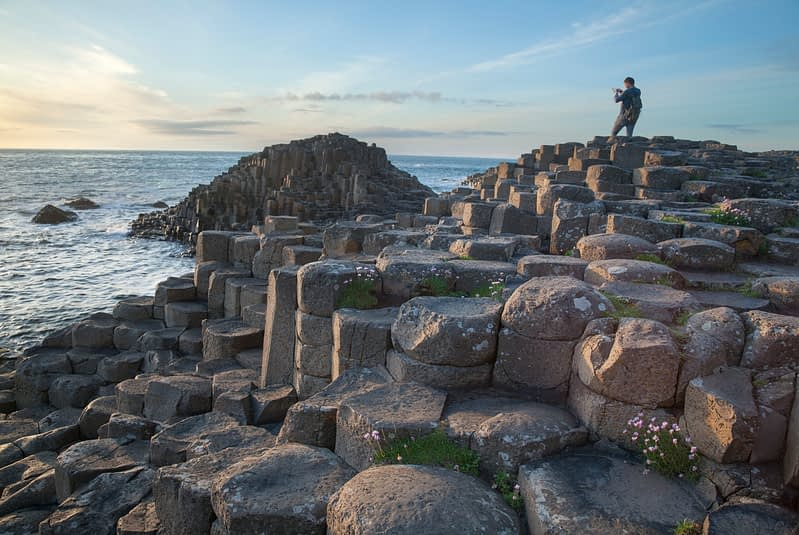 Photographer at the Giant's Causeway, Causeway Coast, County Antrim, Northern Ireland.