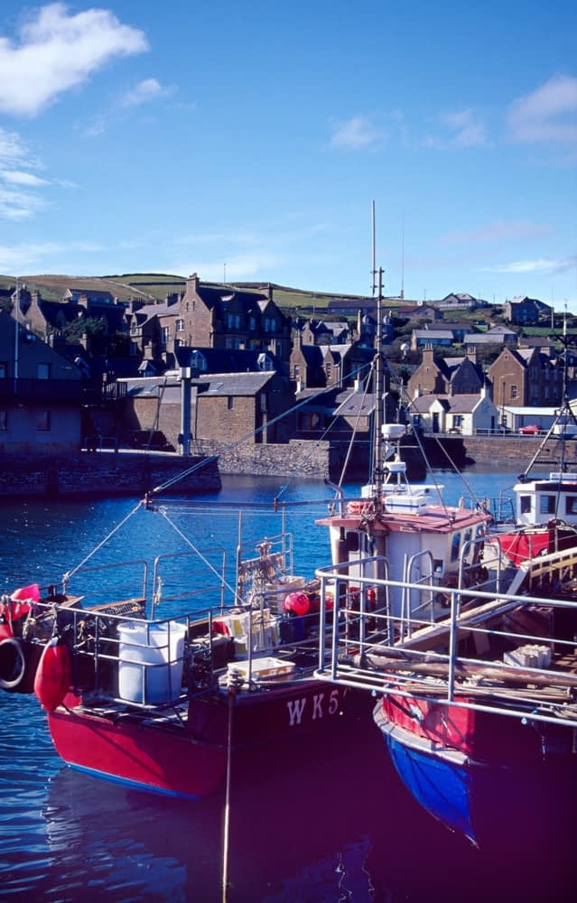 Fishing boats in Stromness harbour, Orkney Islands, Scotland.