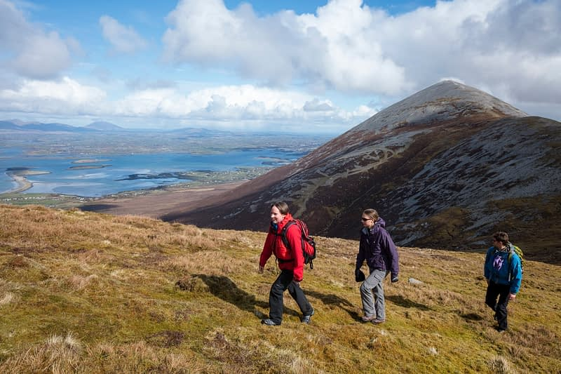 Hikers on Ben Goram, with Croagh Patrick behind, County Mayo, Ireland.