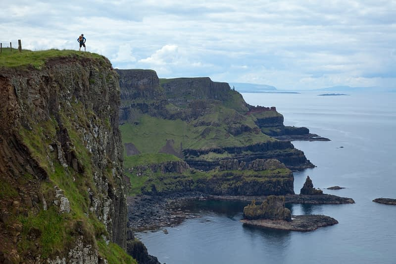 Walker, Benbane Head, County Antrim, Northern Ireland.