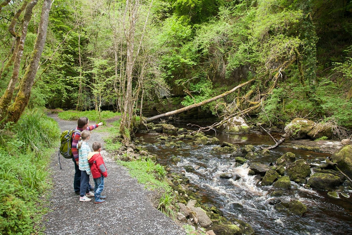 Family walking in Cladagh Glen Nature Reserve, County Fermanagh, Northern Ireland.