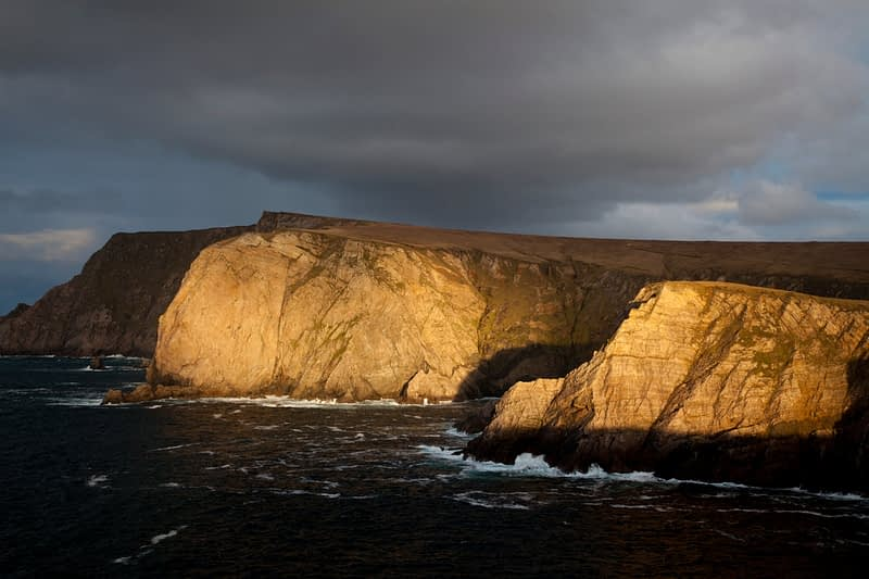 Evening light on Benwee Head, North Mayo seacliffs, County Mayo, Ireland.