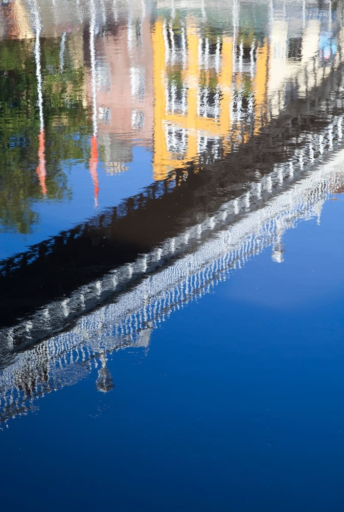 Reflection of Ha'penny Bridge across the River Liffey, Dublin, Co Dublin, Ireland.