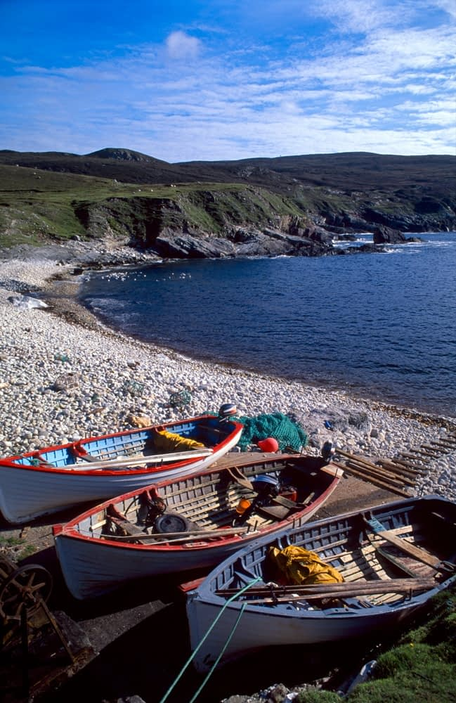 Lobster boats pulled up on shore at Port, Co Donegal, Ireland.